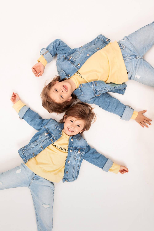 Are Dentists Bulk Billed Free Dental Treatment for Kids Image Blog on Morgan Street Dental Centre -Two Girls Lying on the Floor