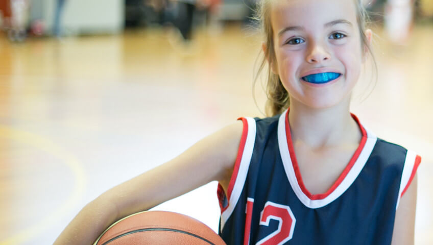 Morgan Street Dental Centre Sports Mouthguard - Sporty Beautiful Girl with Blue Mouthguard dentistwaggasportsmouthguard