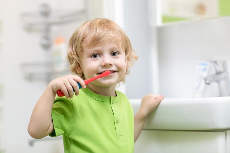 Morgan Street Dental Centre Children's Dentistry - Adorable Child Brushing Teeth in Green Shirt