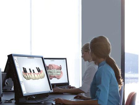 Morgan Street Dental Centre Dental Implants Image - Dentists Working on Computer with Dental Implants
