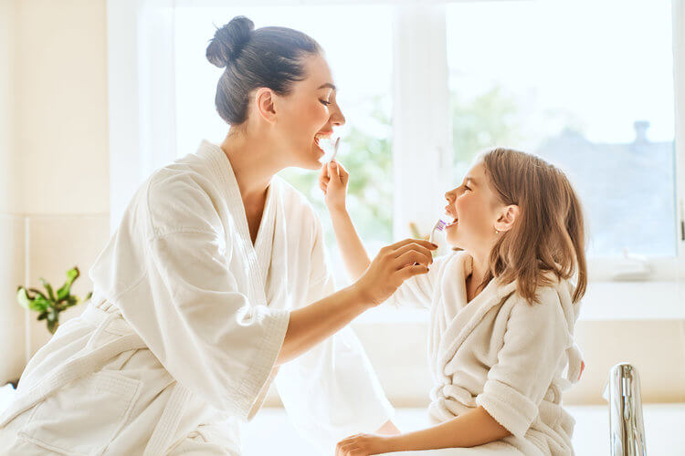 Morgan Street Dental Centre Preventive Care and Dental Hygiene - Mother and Daughter Brushing each other