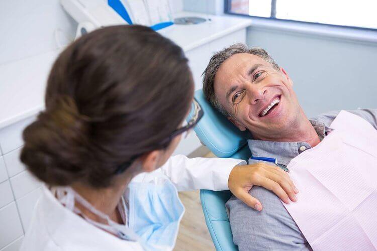 Morgan Street Dental Centre Worn Down Dentition - Elderly Man Smiling in a Dental Chair Happy